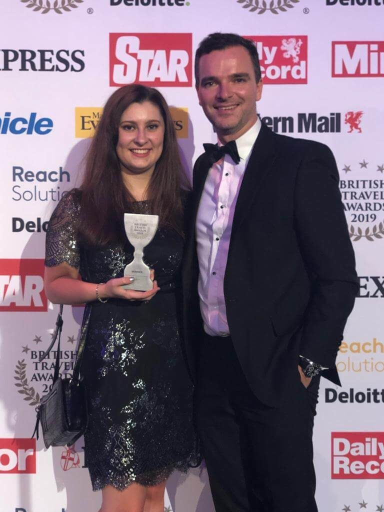 Richard Singer and Rae Coppola from icelolly.com holding British Travel Award 2019 Trophy
