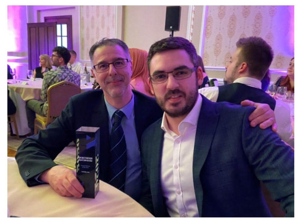 icelolly.com CTO Tony Iacobucci and Head of Software Engineering, Elliot Wrigh holding the Travel Website of the Year trophy at the Northern Dev Awards 2020